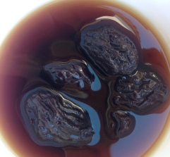 Prunes soaking in pedro ximenez sherry, ahead of being wrapped in beef fillets for olives: http://wp.me/p26Y0F-11o